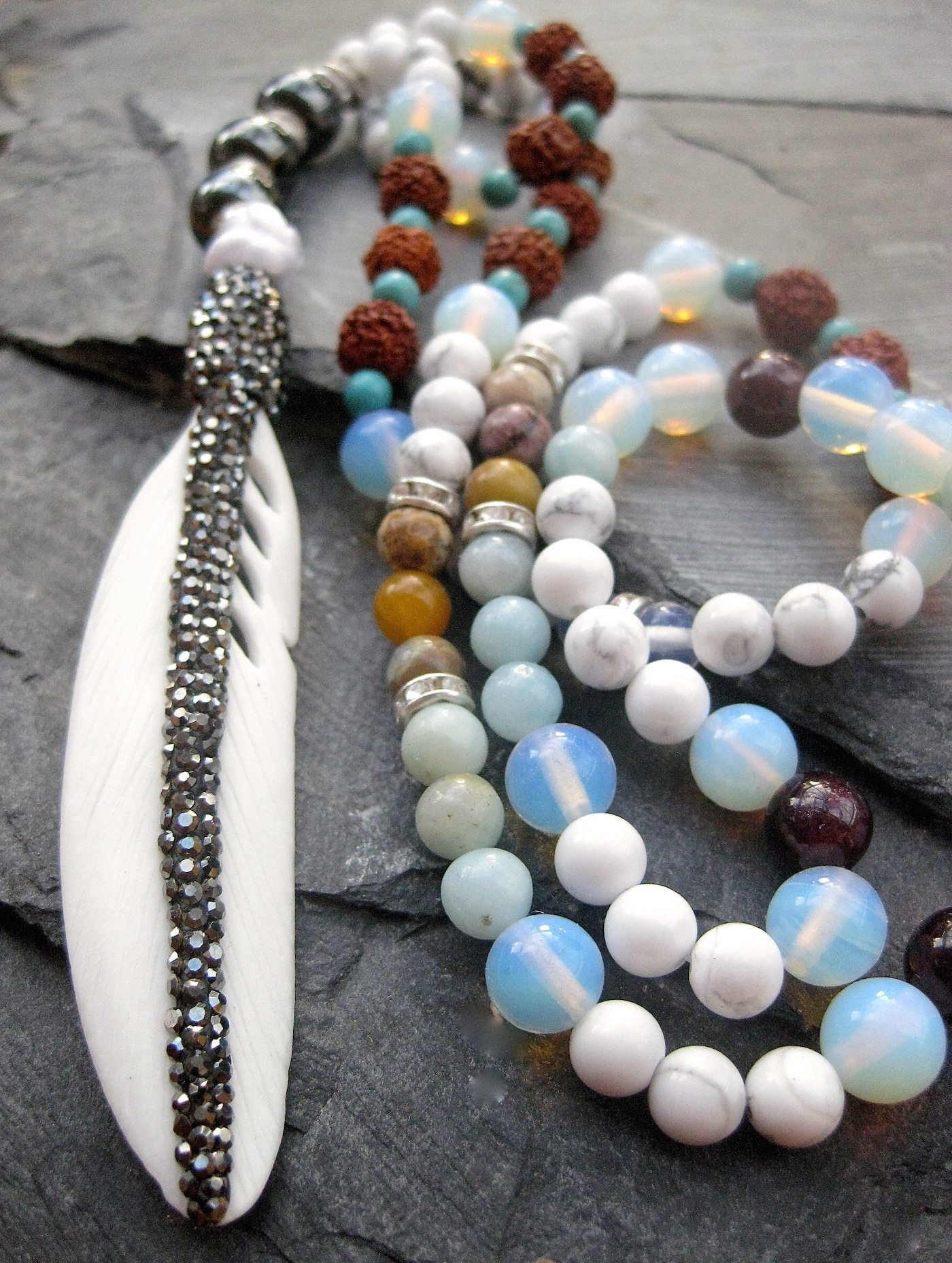 mala necklace with feather bone, moonstone, garnet, multi coloured amazonite necklace, rudrasha beads, turqiouse, white howlite beads semi precious stones